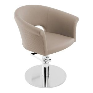A beige coloured salon styling chair